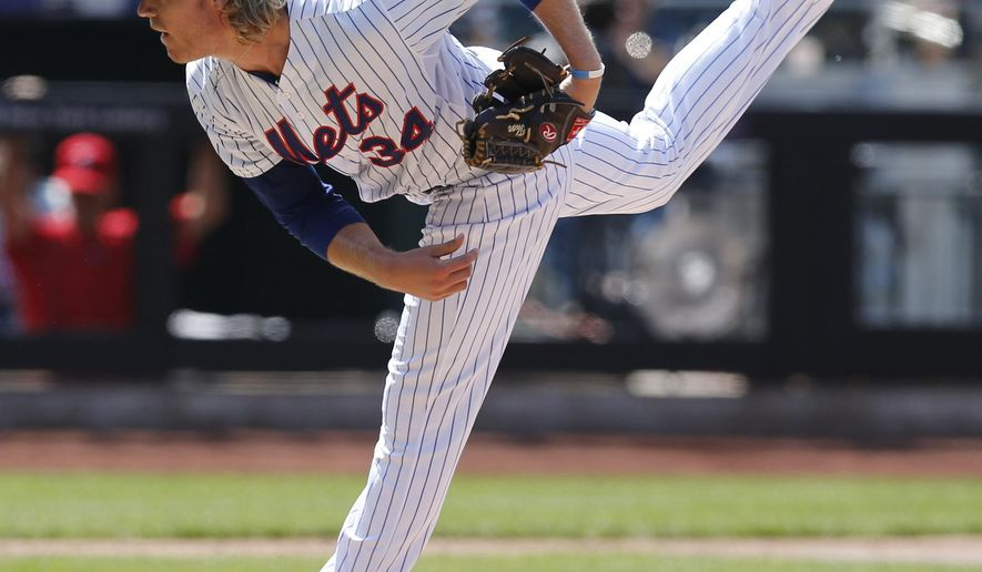 New York Mets starting pitcher Noah Syndergaard (34) follows through with a pitch in the sixth inning of a baseball game against the Philadelphia Phillies in New York, Wednesday, May 27, 2015. (AP Photo/Kathy Willens)