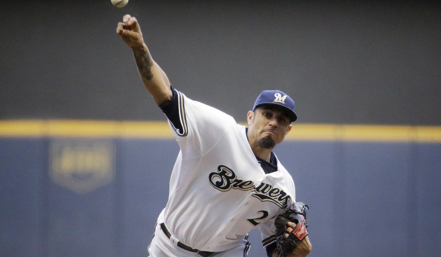 Milwaukee Brewers starting pitcher Matt Garza throws during the first inning of a baseball game against the San Francisco Giants Tuesday, May 26, 2015, in Milwaukee. (AP Photo/Morry Gash)