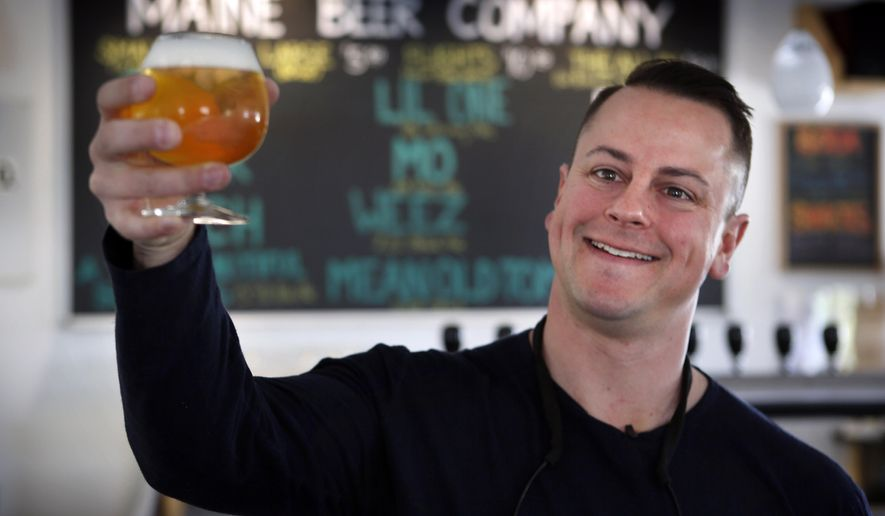 In this May 7, 2015 photo, Dan Kleban, a co-owner of the Maine Beer Company, poses in the company's tasting room in Freeport, Maine. Craft beer now accounts for 1 of 10 beers sold. (AP Photo/Robert F. Bukaty)