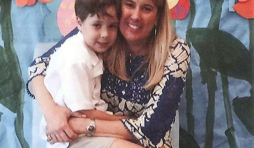 ADDS THAT MICHELLE MARIE CAREY-CHARBA WAS CONFIRMED DEAD WEDNESDAY, MAY 27 - This undated photo provided by the Hays County Sheriff's Office shows Michelle Charba, seated, with William Charba, 6. Both had been missing from Wimberley, Texas since Sunday, May 24, 2015. Michelle Carey-Charba was confirmed as a storm related death on Wednesday, May 27, 2015. William Charba has not yet been found. More than 100 people continued to search along the Blanco River on Wednesday for other bodies but were slowed by large debris fields. (Hays County Sheriff's Office, via AP)