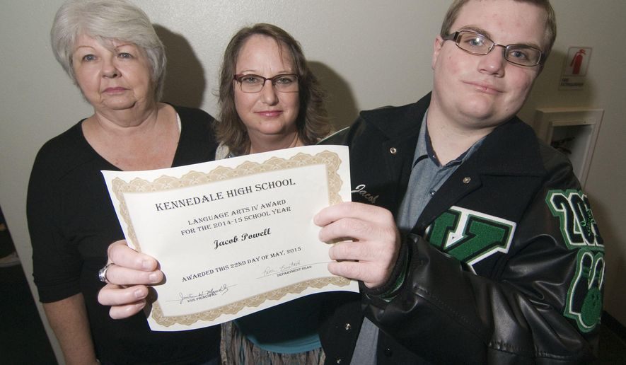 In this May 22, 2015 photo, Jacob Powell, right, holds his Language Arts IV award from Kennedale High School, as he poses for a photo with his mother Phyllis Powell, left, and teacher Kim Brown in Arlington, Texas. Jacob Powell, a student with medical difficulties, with help from doting doctors and nurses and home instruction with his special-education teacher is happily winding down his senior year at Kennedale High School. (Willis Knight/The Fort Worth Star-Telegram via AP)