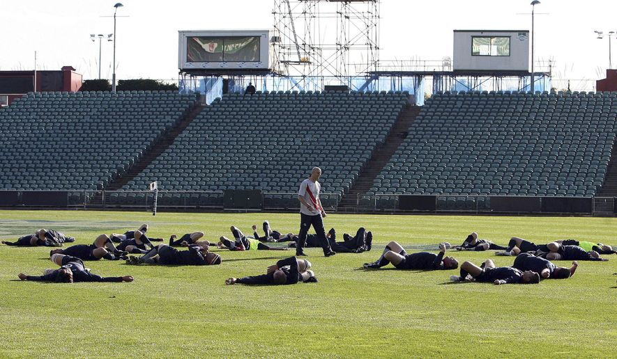 FILE - In this June 10, 2008 file photo, England's rugby team players stretch during their training at North Harbour Stadium in Auckland, New Zealand. The FIFA Under-20 World Cup kicks off Saturday, May 30, 2015 in New Zealand. The final will be held at Auckland's 25,000-seat North Harbour Stadium on June 20. (Wayne Drought/NZPA via AP, File) NEW ZEALAND OUT