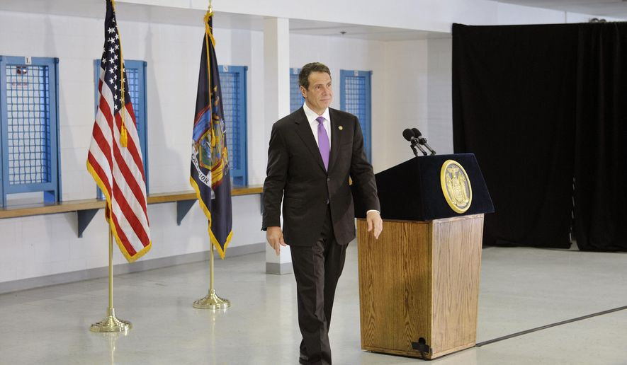 Gov. Andrew Cuomo walks away from the podium at the end of a news conference at the Greene Correctional Facility on Thursday, May 28, 2015, in Coxsackie, N.Y.  Cuomo is promoting a legislative proposal to raise the age of criminal responsibility from 16 to 18 years of age. That would spare minors from adult prisons and jails. (Paul Buckowski/The Albany Times Union via AP)  TROY, SCHENECTADY; SARATOGA SPRINGS; ALBANY OUT