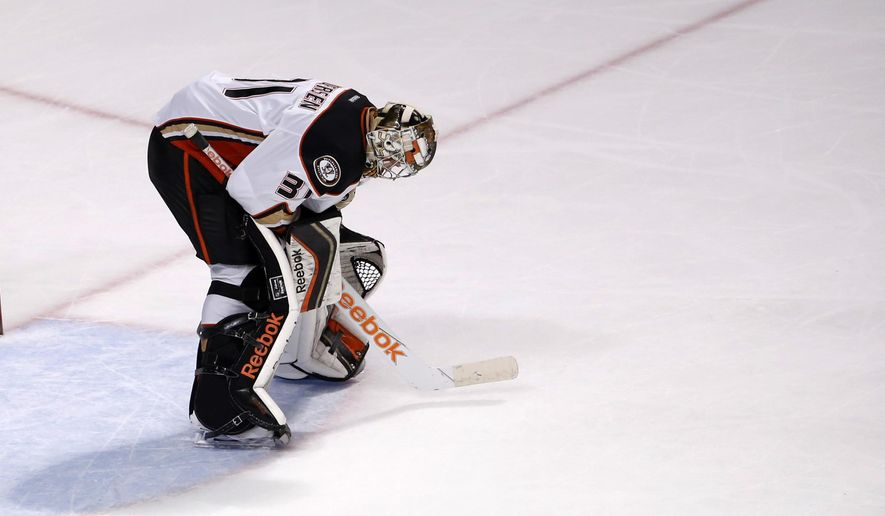 Anaheim Ducks goalie Frederik Andersen looks down at the ice after allowing a Chicago Blackhawks center Andrew Shaw goal during the third period in Game 6 of the Western Conference finals of the NHL hockey Stanley Cup playoffs, Wednesday, May 27, 2015, in Chicago. Chicago won 5-2. (AP Photo/Charles Rex Arbogast)