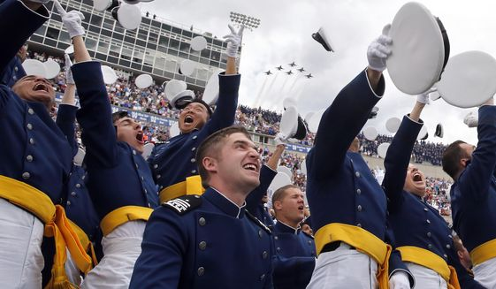 Air Force Academy graduates throw their caps into the air as F-16 jets from the Thunderbirds make a flyover, at the completion of the graduation ceremony for the class of  2015, at the U.S. Air Force Academy, in Colorado Springs, Colo., Thursday, May 28, 2015.  (AP Photo/Brennan Linsley) **FILE**