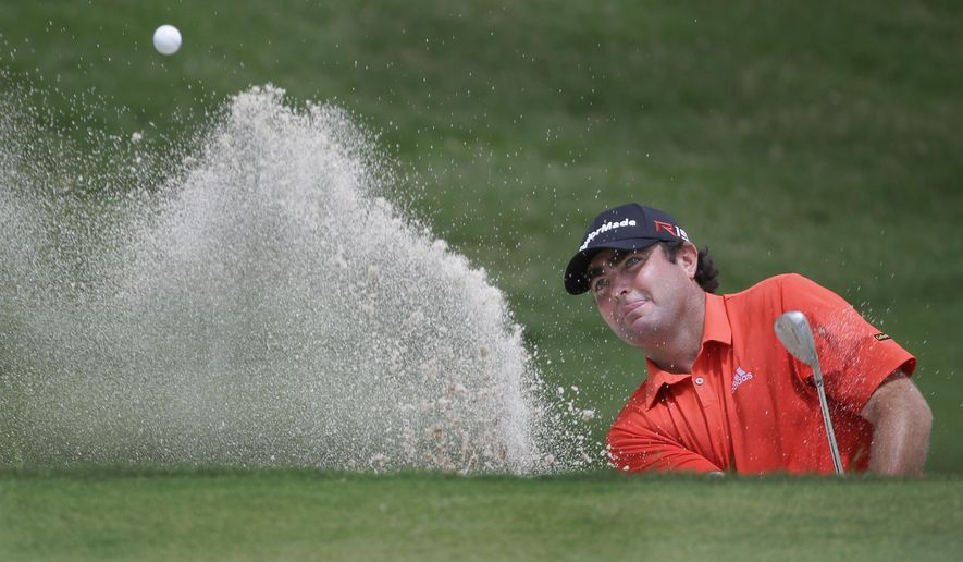 Steven Bowditch hits from the sand to the 16th green during the first round of the Byron Nelson golf tournament, Thursday, May 28, 2015, in Irving, Texas. (AP Photo/LM Otero)