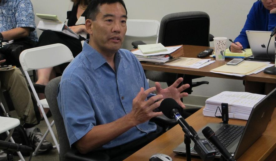 Les Kondo, executive director of the Hawaii Ethics Commission, talks about his accomplishments during the public portion of a commission meeting on Wednesday, May 27, 2015, in Honolulu. Kondo's performance is being evaluated after there were some complaints that he has been too strict about state officials and employees who receive gifts. (AP Photo/By Cathy Bussewitz)