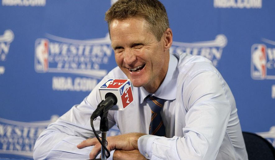 Golden State Warriors head coach Steve Kerr smiles at a news conference after Game 5 of the NBA basketball Western Conference finals against the Houston Rockets in Oakland, Calif., Wednesday, May 27, 2015. The Warriors won 104-90 and advanced to the NBA Finals. (AP Photo/Ben Margot)