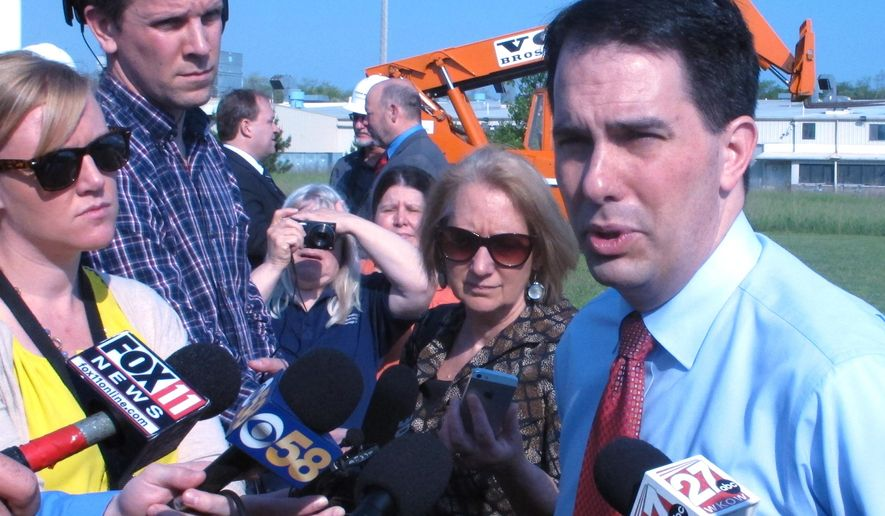 Gov. Scott Walker discusses ongoing state budget negotiations on Thursday, May 28, 2015, in Portage, Wis. Walker says he remains opposed to a vehicle registration fee increase or gas tax hike to help pay for state highway construction and repair in Wisconsin. (AP Photo/Scott Bauer)