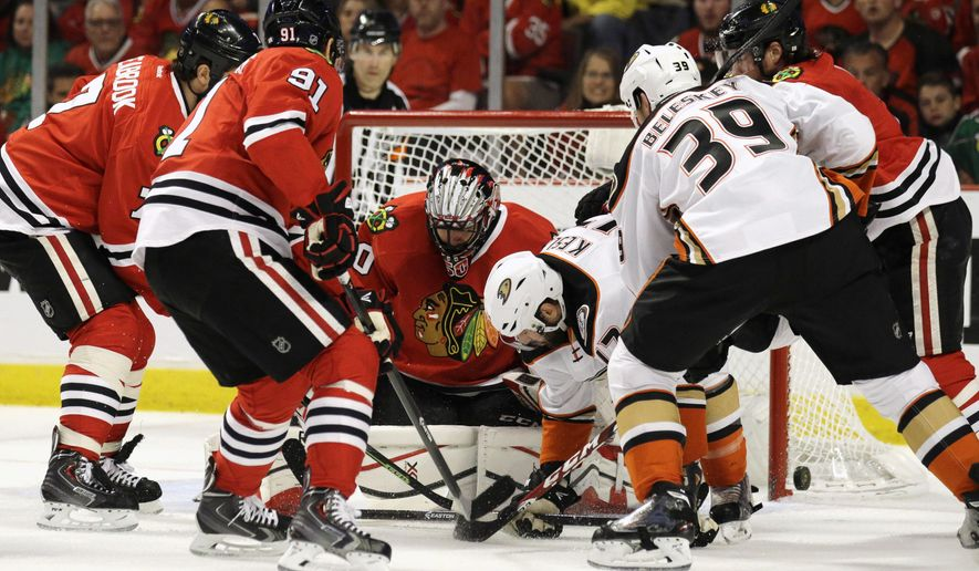 Chicago Blackhawks goalie Corey Crawford (50) stops an Anaheim Ducks center Ryan Kesler (17) shot during the first period in Game 6 of the Western Conference finals of the NHL hockey Stanley Cup Playoffs, Wednesday, May 27, 2015, in Chicago. (AP Photo/Nam Y. Huh)