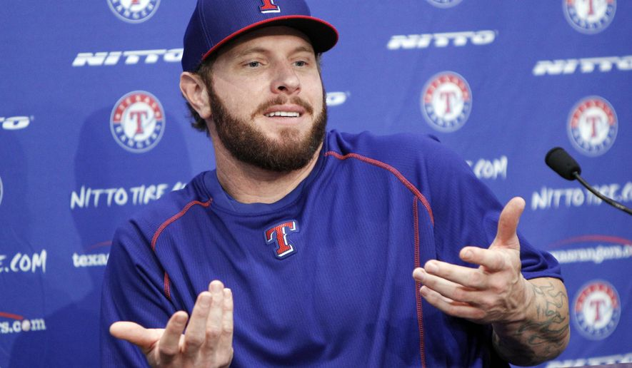 Texas Rangers outfielder Josh Hamilton answers questions during a news conference, Thursday, May 28, 2015, in Arlington, Texas. Hamilton will play his first home game with the Rangers since being reacquired from the Los Angeles Angels. (AP Photo/Brandon Wade)