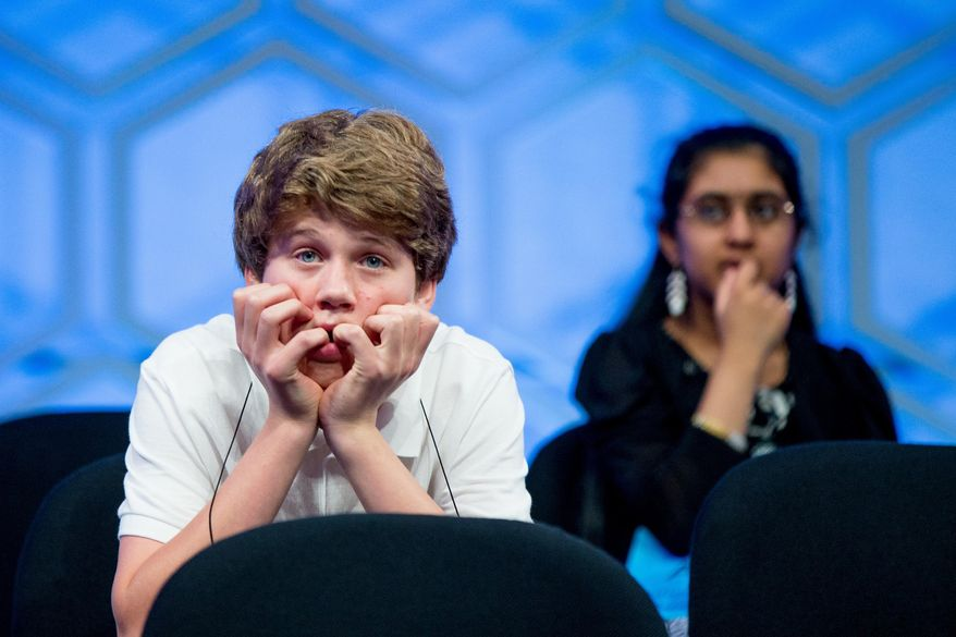 Cole Shafer-Ray, 14, of Oklahoma City, Okla., left, and Ankita Vadiala, 13, of Manassas, Va., sit on stage during the semifinals of the 2015 Scripps National Spelling Bee, Thursday, May 28, 2015, in Oxon Hill, Md. (AP Photo/Andrew Harnik)