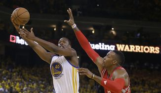 Golden State Warriors forward Harrison Barnes (40) shoots against Houston Rockets center Dwight Howard (12) during the second half of Game 5 of the NBA basketball Western Conference finals in Oakland, Calif., Wednesday, May 27, 2015. (AP Photo/Ben Margot)
