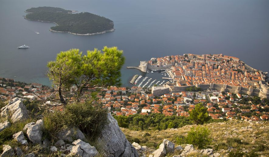 This Oct. 4, 2014 photo shows the Dubrovnik old town from a hill. Despite surging opposition to pumping crude in the waters of one of Europe's fastest-growing summer travel destinations, the Croatian government is determined to boost the state's poor finances by offering several exploration licenses to foreign energy companies. (AP Photo/Darko Bandic)