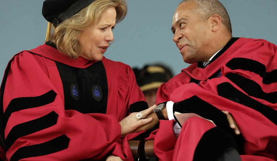 Soprano Renee Fleming, left, and former Massachusetts Gov. Deval Patrick, right, talk during Harvard University commencement exercises, Thursday, May 28, 2015, in Cambridge, Mass. Fleming received an honorary Doctor of Music degree while Patrick received an honorary Doctor of Laws degree during the ceremonies. (AP Photo/Steven Senne)