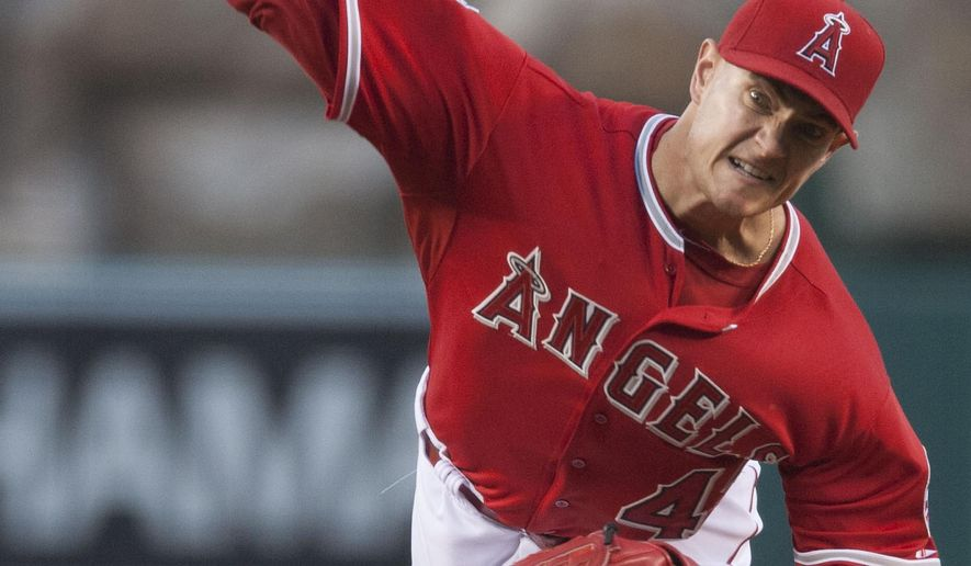 Los Angeles Angels Garrett Richards pitches against the San Diego Padres Wednesday night, May 27, 2015, in Anaheim, Calif. (Kevin Sullivan/The Orange County Register via AP)   MAGS OUT; LOS ANGELES TIMES OUT; MANDATORY CREDIT