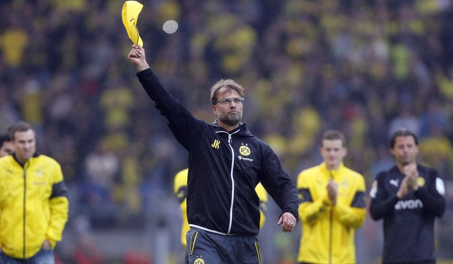 FILE - In this May 23, 2015 file photo Dortmund's head coach Juergen Klopp waves his hat to say farewell to supporters after  the German first division Bundesliga soccer match between BvB Borussia Dortmund  and Werder Bremen in Dortmund, western Germany. Klopp left the club after seven years.  (AP Photo/Frank Augstein, file)