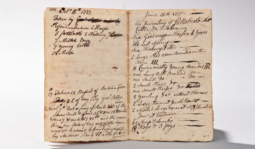 This photo provided by Skinner, Inc., shows a Revolutionary War-era ledger of wealthy Pennsylvania businessman John Roberts III that will be auctioned. In November 1778, Roberts and a fellow Quaker were convicted of treason against the American cause and hanged from a gallows in Philadelphia, despite calls for a pardon from prominent citizens, including three signers of the Declaration of Independence. (Courtesy of Skinner, Inc. via AP)