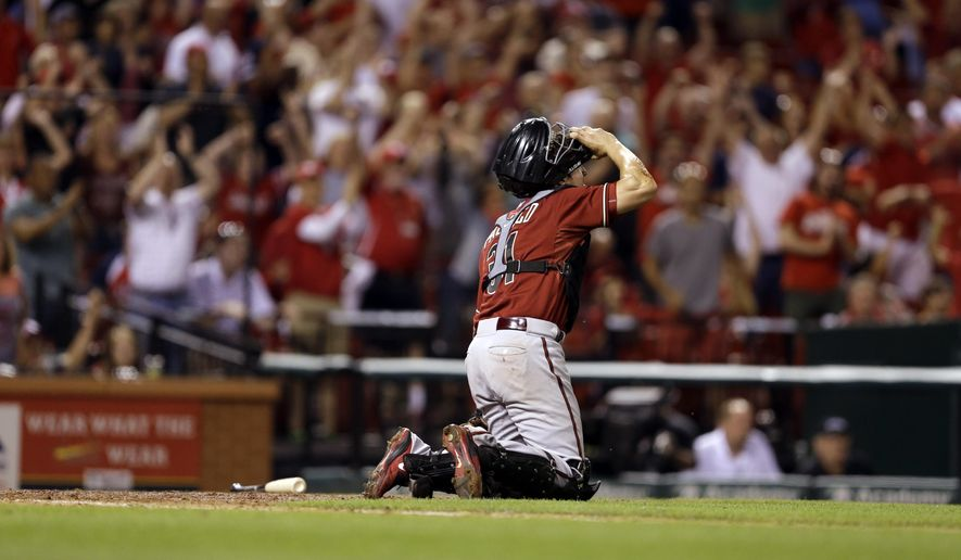 Arizona Diamondbacks catcher Jordan Pacheco gets up slowly after committing a throwing error, allowing St. Louis Cardinals' Matt Carpenter to score the winning run during the ninth inning of a baseball game Wednesday, May 27, 2015, in St. Louis. The Cardinals won 4-3. (AP Photo/Jeff Roberson)