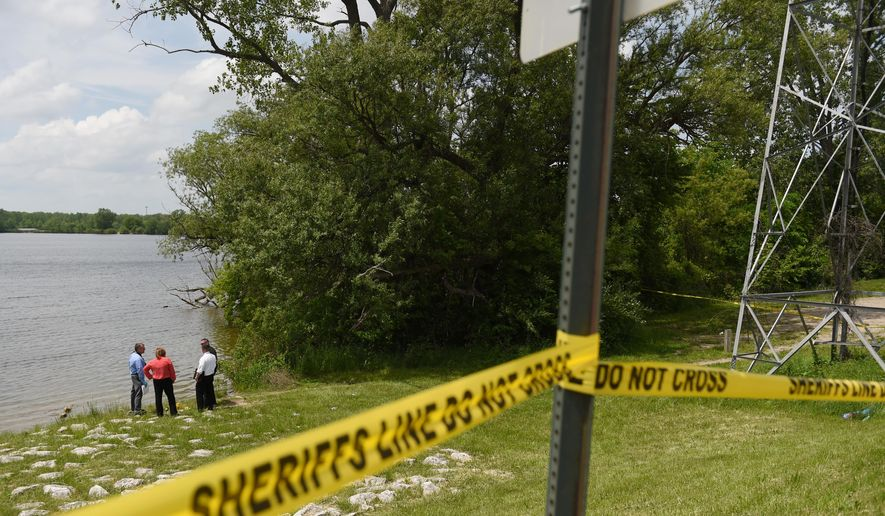 Washtenaw County Sheriff deputies use sonar technology to investigate a scene at Ford Lake off of Bridge Rd. in Ypslianti Township, Mich., on Tuesday, May 26, 2015. A wallet belonging to Tanya Jackson, who has been missing for over a year, was found near the lake.    (Melanie Maxwell/The Ann Arbor News via AP)  LOCAL TV OUT; LOCAL INTERNET OUT