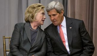 Secretary of State John Kerry speaks with former Secretary of State Hillary Rodham Clinton during the groundbreaking ceremony for the U.S. Diplomacy Center, Wednesday, Sept. 3, 2014, at the State Department in Washington. Kerry hosted five of his predecessors in a rare public reunion for the groundbreaking of a museum commemorating the achievements of American statesmanship. (Associated Press) **FILE**