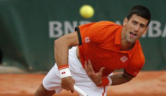 Serbia's Novak Djokovic serves in the second round match of the French Open tennis tournament against Luxembourg's Gilles Muller at the Roland Garros stadium, in Paris, France, Thursday, May 28, 2015. (AP Photo/Francois Mori)