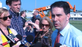 """Several former top Iowa GOP officials said privately that if Wisconsin Gov. Scott Walker walks on the state's Aug. 8 straw poll, it's """"dead."""" (Associated Press)"""