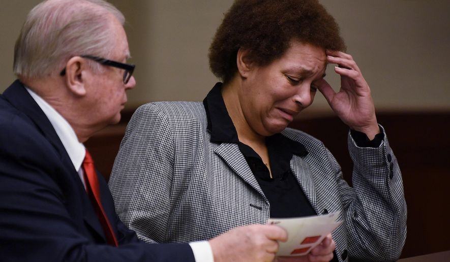 FILE - In this Feb. 5, 2015, file photo, Tewana Sullivan, right, alongside her attorney, John McWilliams, reacts while looking at photographs of herself when she was arrested, during a court hearing in Livonia, Mich. Sullivan, accused of killing a friend with a slow cooker during a political dispute while very drunk, pleaded guilty Thursday, May 28, 2015, to second-degree murder in a deal with prosecutors. (AP Photo/The Detroit News, Robin Buckson, File) DETROIT FREE PRESS OUT; HUFFINGTON POST OUT