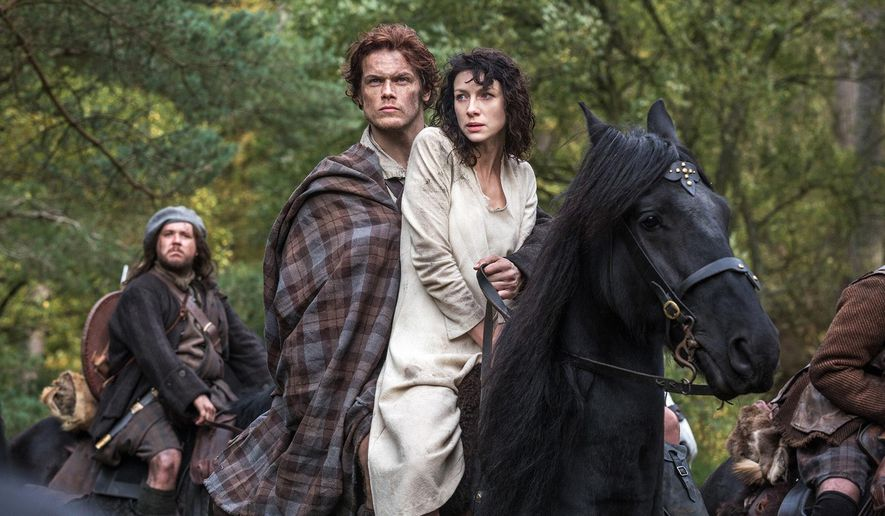 "This photo released by Sony Pictures Television shows Caitriona Balfe as Claire Randall, right, and Sam Heughan as Jamie Fraser, center, and Grant O'Rourke as Rupert MacKenzie, in a scene from Starz' TV series, ""Outlander."" (AP Photo/Sony Pictures Television, Ed Miller, File)"