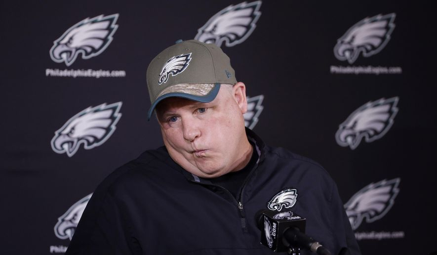 Philadelphia Eagles head coach Chip Kelly listens to a question from a reporter during a news conference before organized team activities at the NFL football team's practice facility, Thursday, May 28, 2015, in Philadelphia. (AP Photo/Matt Slocum)