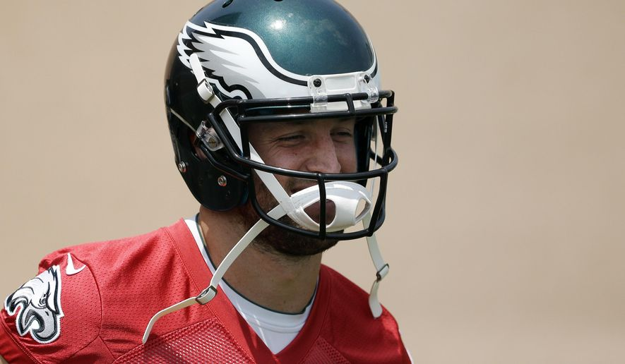Philadelphia Eagles' Tim Tebow smiles as he jogs onto the field for organized team activities at the NFL football team's practice facility, Thursday, May 28, 2015, in Philadelphia. (AP Photo/Matt Slocum)