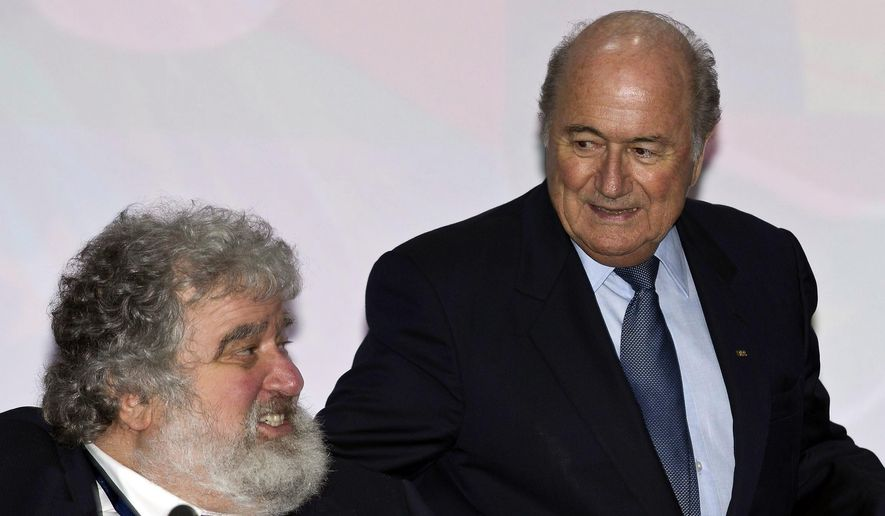 FILE - This is a Wednesday, June 1, 2011  file photo of FIFA president Joseph Blatter, right, welcomes former CONCACAF secretary general Chuck Blazer prior to the 61st FIFA Congress held at the Hallenstadion in Zurich, Switzerland. Blazer was one of four men who pleaded guilty in the Justice Department's corruption investigation into FIFA announced Wednesday May 27, 2015. (Keystone, Patrick B. Kraemer, File via AP)