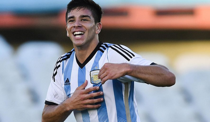 FILE - In this Feb. 4, 2015 file photo, Argentina's Giovanni Simeone celebrates after scoring a goal against Paraguay during a South America Under-20 soccer match in Montevideo, Uruguay. Though it will be staged on the opposite end of the earth from the most glamorous leagues and the turmoil of corruption investigations into senior soccer officials, the under-20 World Cup is set to be a showcase for a new generation of talent. Simeone, who was the leading scorer in the qualifying tournament with nine goals, is expected to be among front-runners for the Golden Ball. (AP Photo/Matilde Campodonico, File)