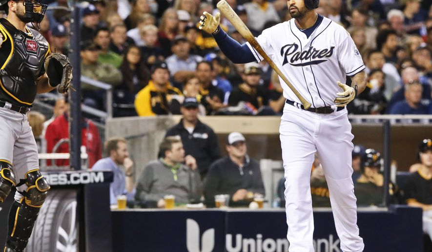 San Diego Padres' Matt Kemp tosses his bat into the air after striking out against the Pittsburgh Pirates during the fourth inning in a baseball game Thursday, May 28, 2015, in San Diego. (AP Photo/Don Boomer)