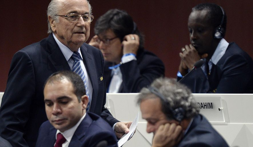 FIFA president Joseph S. Blatter, left, walks past Prince Ali bin al-Hussein, left, and UEFA President Michel Platini, center, during the 65th FIFA Congress held at the Hallenstadion in Zurich, Switzerland, Friday, May 29, 2015, where he will run for re-election as FIFA head. (Walter Bieri/Keystone via AP)