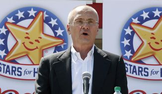 In this Aug. 6, 2014, file photo provided by CKE Restaurants, company CEO Andy Puzder speaks at a news conference in Austin, Texas, to highlight Carl's Jr.'s commitment to the state. (Jack Plunkett/CKE Restaurants via AP)