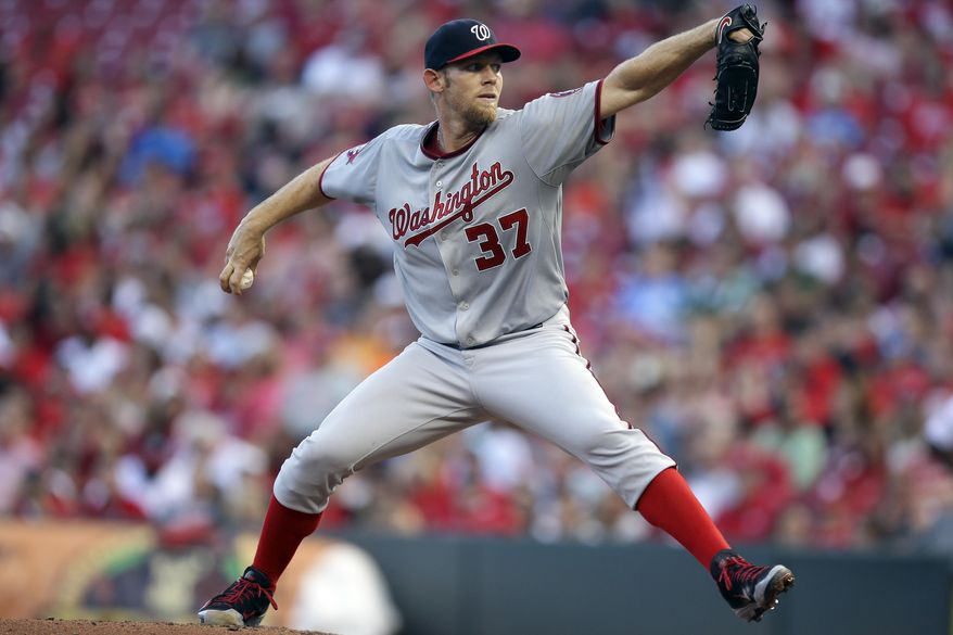 Washington Nationals starting pitcher Stephen Strasburg throws in the second inning of a baseball game against the Cincinnati Reds, Friday, May 29, 2015, in Cincinnati. (AP Photo/John Minchillo)