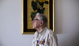 In this Tuesday, May 19, 2015 photo, British Jewish World War II veteran Norman Cohen who landed on the beaches of Normandy on D-Day with the British 2nd Army as a radio operator under the command of General Miles Dempsey, poses for a photo at his home in Jerusalem.  Cohen is among a dwindling population of Jewish war veterans who battled the Nazis before immigrating to Israel - a group that until recently received little recognition in the Jewish state. (AP Photo/Oded Balilty)