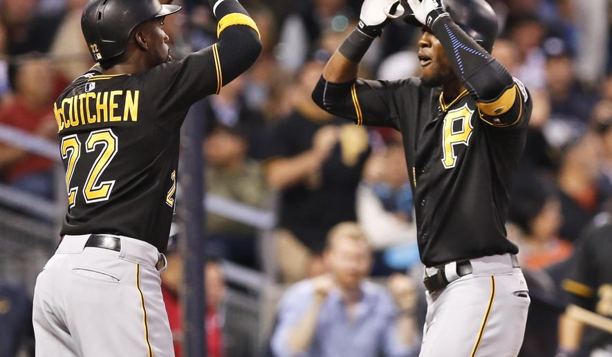 Pittsburgh Pirates' Andrew McCutchen, left, celebrates with Starling Marte after Marte's two-run home run against San Diego Padres during the third inning in a baseball game Thursday, May 28, 2015, in San Diego. (AP Photo/Don Boomer)