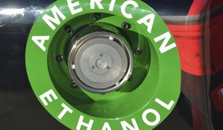 FILE - In this Nov. 1, 2014 file photo, an American Ethanol label is shown on a NASCAR race car gas tank at Texas Motor Speedway in Fort Worth, Texas. The Obama administration is proposing to reduce the amount of ethanol blended in the nation's gasoline, a blow to renewable fuel companies that have pushed to keep high volumes of their product flowing into drivers' gas tanks. The move is unlikely to mean much for consumers or prices at the pump.  (AP Photo/Randy Holt, File)