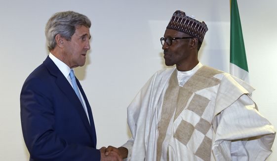 U.S. Secretary of State John Kerry, left, talks with newly inaugurated Nigerian President Muhammadu Buhari, before the start of a formal meeting in Abuja, Nigeria, Friday, May 29, 2015.  Nigerians celebrated their newly reinforced democracy Friday, dancing and singing at the inauguration of President Muhammadu Buhari, the first candidate to beat a sitting president at the polls. (AP Photo/Susan Walsh, Pool)