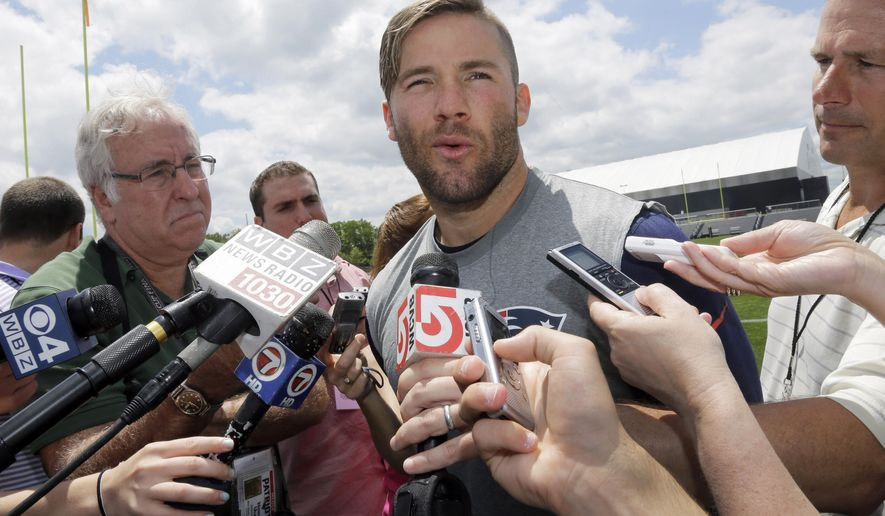 New England Patriots wide receiver Julian Edelman talks with reporters after an NFL football organized team activity, Friday, May 29, 2015, in Foxborough, Mass. (AP Photo/Elise Amendola)