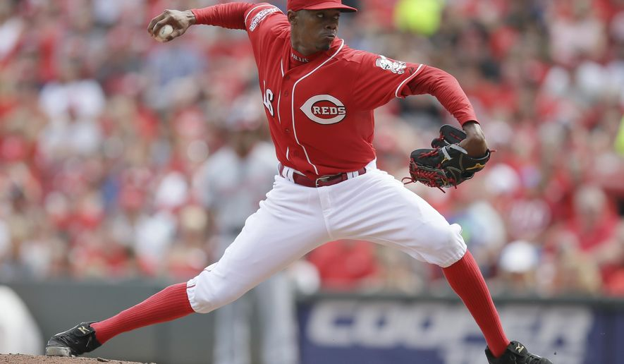 Cincinnati Reds starting pitcher Raisel Iglesias throws in the third inning of a baseball game against the Washington Nationals, Saturday, May 30, 2015, in Cincinnati. (AP Photo/John Minchillo)