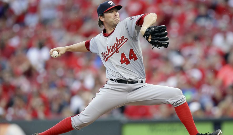 Washington Nationals relief pitcher Casey Janssen throws in the eighth inning of a baseball game against the Washington Nationals, Saturday, May 30, 2015, in Cincinnati. The Reds won 8-5. (AP Photo/John Minchillo)