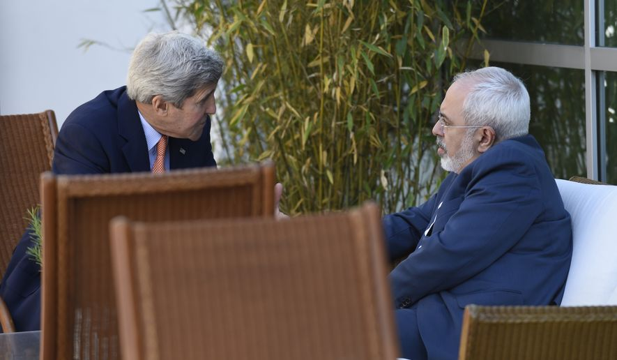 U.S. Secretary of State John Kerry (left) talks with Iranian Foreign Minister Mohammad Javad Zarif in Geneva on May 30, 2015. Top U.S. and Iranian diplomats are gathering in Geneva this weekend, hoping to bridge differences over a nuclear inspection accord and economic sanctions on Tehran. (Associated Press) **FILE**