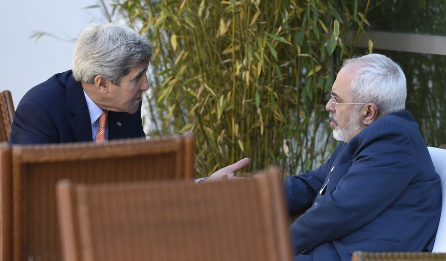 U.S. Secretary of State John Kerry, left, talks with Iranian Foreign Minister Mohammad Javad Zarif, in Geneva, Switzerland, Saturday, May 30, 2015.  Top U.S. and Iranian diplomats are gathering in Geneva this weekend, hoping to bridge differences over a nuclear inspection accord and economic sanctions on Tehran. (AP Photo/Susan Walsh, Pool)