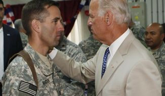 FILE - In this Saturday, July 4, 2009. file photo, U.S. Vice President Joe Biden, right, talks with his son, U.S. Army Capt. Beau Biden, at Camp Victory on the outskirts of Baghdad, Iraq. On Saturday, May 30, 2015, Vice President Biden announced the death of son, Beau, from brain cancer. (AP Photo/Khalid Mohammed, Pool)