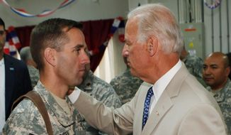 On Saturday, Vice President Joe Biden (right) announced the death of son, Beau, from brain cancer. A former attorney general of Delaware, the younger Mr. Biden was an Iraq war veteran and a likely candidate to run for governor of his home state. (Associated Press)