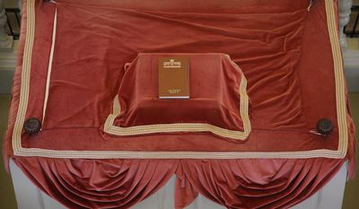 """In this Thursday, May 28, 2015 photo, a siddur (prayer book), sits atop the """"Bima"""" (reader's deck) at the Touro Synagogue, the nation's oldest at 250 years old, in Newport, Rhode Island. (AP Photo/Stephan Savoia)"""