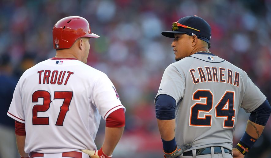 Los Angeles Angels' Mike Trout, left, and Detroit Tigers first baseman Miguel Cabrera talk at first base during the fifth inning of a baseball game, Sunday, May 31, 2015, in Anaheim, Calif. (AP Photo/Mark J. Terrill)